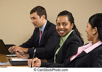 Business meeting - Businesspeople sitting at conference...