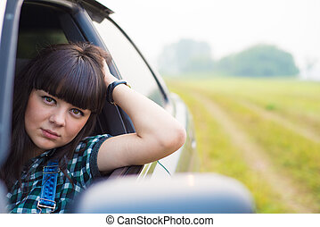 Portrait of beautiful girl sitting in the car - Portrait of...
