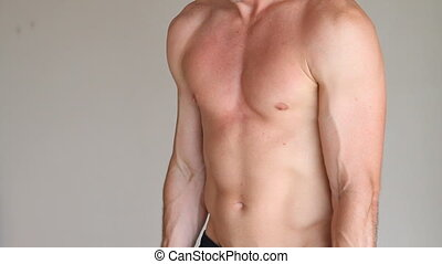 Man Dumbbell Exercises - Bare chested man uses dumbbell for...