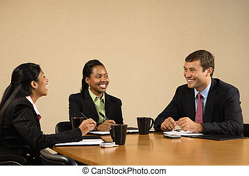 Businesspeople in conference. - Businesspeople sitting at...