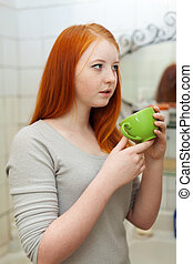 Teenager gargling throat in bathroom - Teenager gargling...