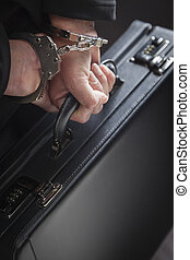 Woman In Handcuffs Carrying Briefcase - Woman Wearing...
