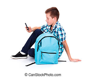 Boy with Smart Phone - Boy in blue shirt using his smart...