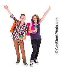 Joyful Students - Adolescents with backpack and books in...