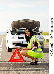Woman placing emergency triangle