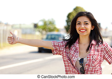 Hitch-hiker Woman - Pretty smiling lady hitch-hiking in the...