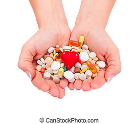 Supplements - Woman holding a handful medications with...