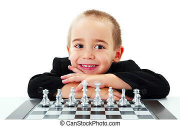 Kid ready to play chess - Happy little boy ready to play...