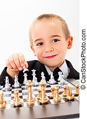 Little kid opening chess game - Wise little child player...