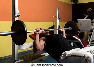 Bench Press Workout - Bodybuilder In Gym Exercising On The...