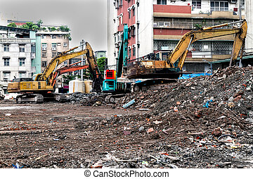 Earthmovers demolishing building - Construction site with...