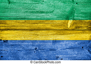 Gabon Flag painted on old wood plank background