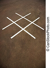 Tic tac toe game - Tic tac toe game on playground concrete