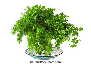 seasoning green dill and parsley on a plate - a seasoning...