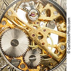 Clockwork inside mechanism in closeup