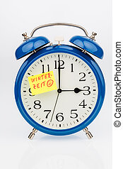 changeover to winter time - an alarm clock with a note as a...