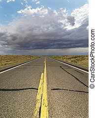 Empty rural road - Empty two lane highway leading to desert...