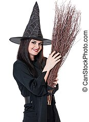 Young witch coquette with broom isolated on white background