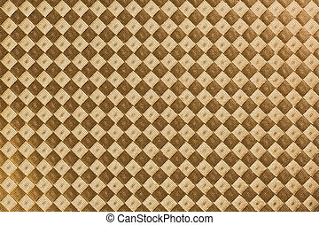 Rhomb-textured paper - Golden paper textured with embossed...
