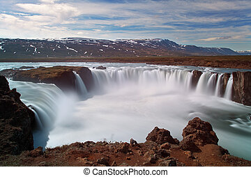 Godafoss waterfalls with mountain in Iceland
