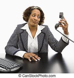 Annoyed businesswoman. - Businesswoman sitting at desk...