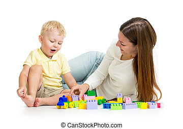 child and his mom play together with block toy