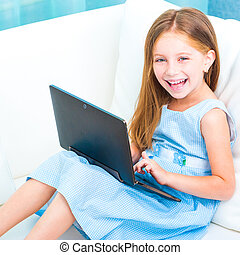 little cute girl with a laptop