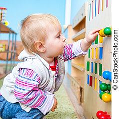 little girl in the classroom early development - little boy...