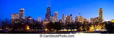 Chicago skyline panorama with urban skyscrapers at dusk, IL,...