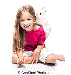 little girl with her rabbit