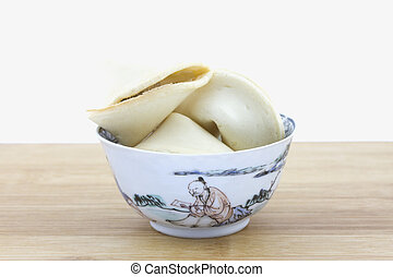 Chinese fortune cookies in bowl - Chinese fortune cookies in...
