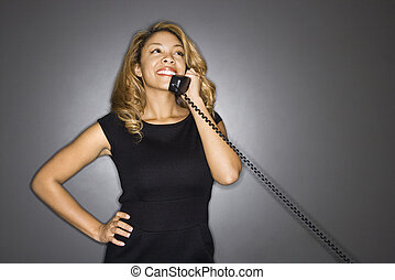 Laughing woman on telephone.