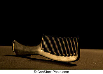 Comb on a dark background