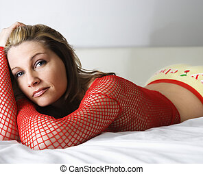 Pretty woman in bed - Sexy Caucasian woman lying on bed...