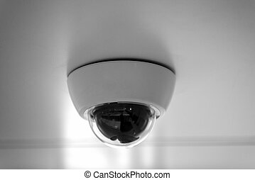 Modern security camera on the wall