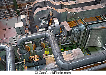 Large industrial interior with power generator in a building