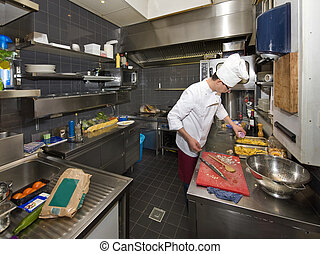 Chefs Kitchen - A chef in a profesional kitchen, preparing...