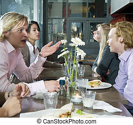 People at lunch - A group of people having lunch in a...
