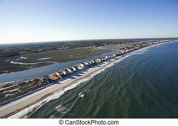 Beachfront homes. - Aerial view of houses in row on...