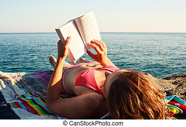 Reading book in the beach - Girl Reading book in the beach,...