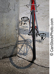 Red bicycle from behind - Red bicycle in urban setting; Red...