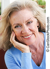 Beautiful Middle Aged Blond - Closeup headshot of a...