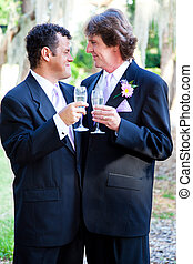 Gay Wedding Couple - Champagne Toast - Gay couple toasting...
