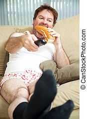Lazy Day at Home - Unemployed man sitting on the couch in...