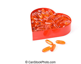 Fish oil pills in red heart shaped box - isolated
