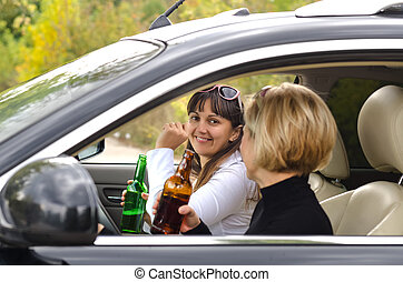 Matured women - Happy matured women drinking alcohol inside...
