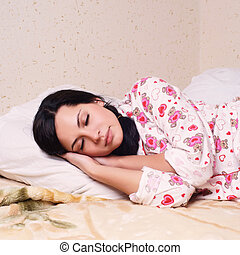pretty young brunette woman sleeping