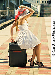 young girl with a suitcase