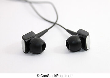 Earphones over white background