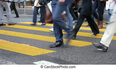 Zebra crossing Zurich - HD 1080p - Busy crowds walk over...